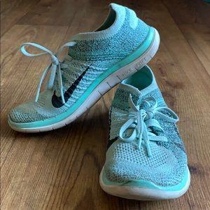 Baby blue Nike frees 4.0